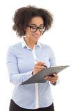 Young beautiful african american woman writing something on clip Stock Photography