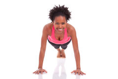 Young beautiful african fitness woman doing push up exercises on Stock Images