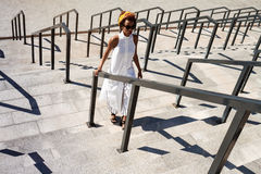 Young beautiful african girl going up stairs walking down city. Royalty Free Stock Photography