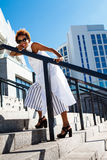 Young beautiful african girl going up stairs walking down city. Royalty Free Stock Photo