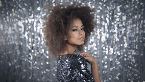 Young beautiful african girl posing in elegant dress, looking at camera. stock video