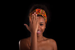 Young beautiful african woman, Isolated over black background Royalty Free Stock Photos