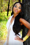 Young Beautiful African Woman Leaning Against a Tree Royalty Free Stock Photos