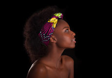 Young beautiful african woman portrait, Isolated over black back Royalty Free Stock Photos