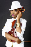 Young Beautiful African Woman Posing with a Violin Royalty Free Stock Photography