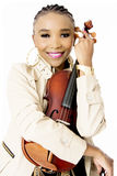 Young Beautiful African Woman Posing with a Violin, Fashion, Studio Shot Royalty Free Stock Photography