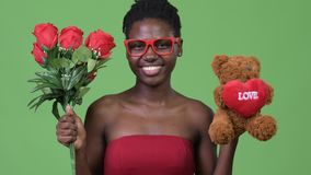Young beautiful African woman ready for Valentine`s day. Studio shot of young beautiful African woman against chroma key with green background stock video footage