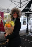Young beautiful African woman showing excitement after receiving flowers stock photography