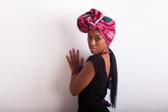 Young beautiful african woman wearing a traditional headscarf Royalty Free Stock Image