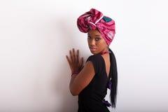 Young beautiful african woman wearing a traditional headscarf. Young beautiful african woman wearing traditional headscarf Royalty Free Stock Image