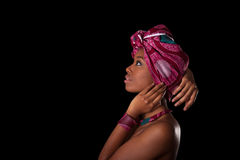 Young beautiful african woman wearing a traditional headscarf, I. Solated over black background Stock Photography