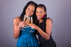 Young beautiful African womans holding a glass of champagne Stock Photo