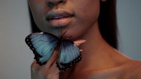 Young beautiful afro girl, with butterflies, beauty portrait stock footage