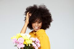 Young beautiful afro girl with flowers stock photo