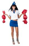 Young beautiful air hostess with 2 big candies Stock Images