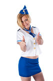 Young beautiful air hostess shows thumbs up Stock Photo