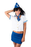Young beautiful air hostess smiles Stock Images