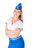 Young beautiful air hostess smiling Stock Images