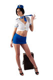 Young beautiful air hostess with vintage suitcase Stock Photography