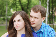 Young beautiful amn and woman looks away Royalty Free Stock Image