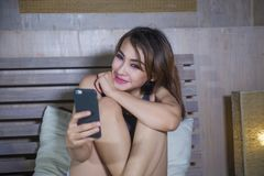 Free Young Beautiful And Happy Girl Sitting On Bed Smiling And Flirti Stock Image - 118613881