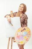Young beautiful artist posing with a drawing easel Stock Photos