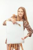 Young beautiful artist posing with a drawing easel Stock Image