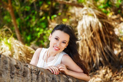 Young beautiful Asian bride under the palm tree on a tropical is Stock Photo