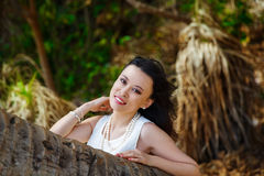 Young beautiful Asian bride under the palm tree on a tropical is Royalty Free Stock Image