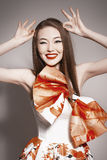 Young beautiful asian brunette building horns Royalty Free Stock Photos