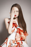 Young beautiful asian brunette cover one eye b Royalty Free Stock Photos