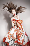 Young beautiful asian brunette, motion shot Royalty Free Stock Photography