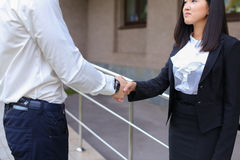 Young beautiful asian business female and caucasian male look at Royalty Free Stock Photos