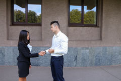 Young beautiful asian business female and caucasian male look at Stock Photography