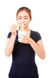 Young beautiful asian girl eating instant noodle Royalty Free Stock Photography