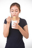 Young beautiful asian girl eating instant noodle Stock Images