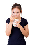 Young beautiful asian girl eating instant noodle Stock Image