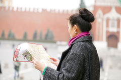 Young beautiful asian girl holding a tourist map of Moscow Royalty Free Stock Image