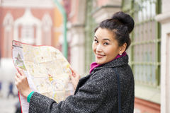 Young beautiful asian girl holding a tourist map of Moscow Stock Images