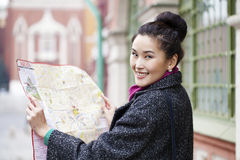 Young beautiful asian girl holding a tourist map of Moscow Stock Image