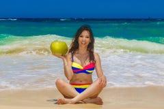 Young beautiful Asian girl with long black hair in bikini, drin royalty free stock photo