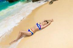 Young beautiful Asian girl with long black hair in bikini, on t royalty free stock photos