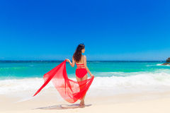 Young beautiful Asian girl with red cloth on the beach of a trop Stock Photo