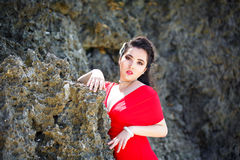 Young beautiful Asian girl in red dress on the beach of a tropic Royalty Free Stock Photos