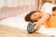 Young beautiful Asian girl waking up after a long sleep, enjoying her time to relax Royalty Free Stock Photo