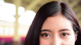Young beautiful asian look at camera close up on eyes thai backpacker travel in bangkok thailand enjoyweekend