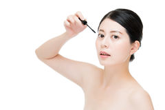 Young beautiful asian woman applying mascara on eyelashes. Asian beauty concept. isolated on white background Stock Photography