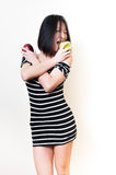 Young beautiful asian woman biting green and red apples Stock Image