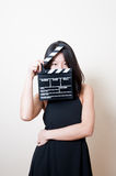 Young beautiful asian woman black dress eyes with clapperboard Stock Images