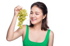 Young beautiful asian woman eating fresh grapes isolated on whit Stock Photos